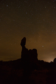 The night sky and Balanced Rock, Arches National Park, Utah