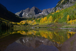 Morning light on the Maroon Bells with Fall Aspens and reflection in Maroon Lake, White River National Forest, Colorado