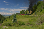 Cumbres & Toltec Scenic Railroad excursion train with steam locomotive No.488 and a view of the Wolf Creek Valley, Colorado