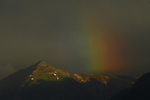 Evening light on Abrams Mountain with colors of a rainbow, Colorado.