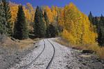 Rail line leading into Fall Aspens, Cumbres & Toltec Scenic Railroad, Colorado