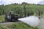 Cumbres & Toltec Scenic Railroad excursion train pulled by locomotive No.484 and performing a blowdown, Colorado