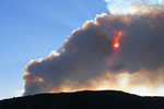 Smoke rising from the East Canyon Wildfire and blocking the sun, June 14, 2020, Southwest Colorado