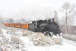Steam locomotive No.493 pulling Cascade Canyon Winter Train in snow, Durango & Silverton Narrow Gauge Railroad, Durango, Colorado