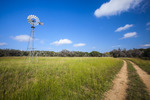 Windmill and road at Block Creek Natural Area in the Texas Hill Country near Comfort, Texas