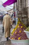 Arab man; olives, market, Essaouira; jallaba; Morocco; People