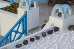 Domestic cat among Rocks and decorations on a terrace, Imerovigli; Santorini; Greece;