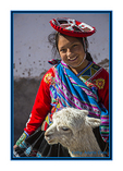Lady with a llama, in Cusco, Peru.  Lady's hat is a symbol of the village she lives in.