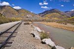Train tracks by the Animas River at Silverton, Colorado. The scenic Durango and Silverton Narrow Gauge Railroad mostly follows the Animas river between Silverton and Durango.