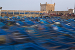 Blue fishing boats, in the harbor at the Sqala du Port, in Essaouira, Morocco, on the southern Atlantic Coast.