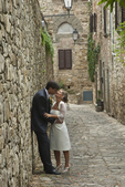 Couple taking their wedding pictures in Montefioralle, Chianti Region, Tuscany, Italy