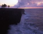 Hawaii, Big Island, Hawaii Volcanoes National Park, Shoreline at sunrise with steam plume from lava flowing into ocean