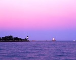 Illinois, Chicago, Chicago Harbor and Chicago Harbor Southeast Guidewall lighthouses on Lake Michigan at dusk