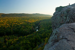 Michigan, Porcupine Mountains Wilderness State Park, hiker on high bluff above Lake of the Clouds with early fall color