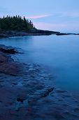 Minnesota, Grand Marais, rocky shore of Lake Superior at sunrise