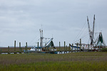 South Carolina, St. Helena Island, shrimp and fishing boats in salt marsh