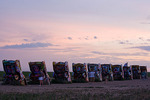 Texas, Amarillo, Cadillac Ranch at dusk with sunset sky