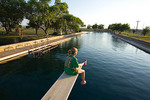 Texas, Balmorhea State Park, spring-fed swimming pool, woman (Whitney Williams, Lubbock, 806 983-1990) on diving board