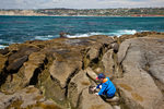 California, San Diego area, La Jolla,rocky shore, Jason Parent looking at tidepools