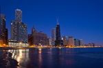 Illinois, Chicago, downtown skyline, including John Hancock Building with Lake Michigan at dusk