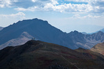 Colorado, San Isabel National Forest, Sawatch Range, Collegiate Peaks Wilderness, Mt. Belford summit (14,197 feet), hikers and distant Mt. Harvard (14,420 feet)