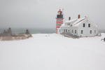 Maine, Quoddy Head State Park in winter snow storm, West Quoddy Head Lighthouse
