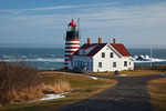 Maine, Quoddy Head State Park, West Quoddy Head Lighthouse in winter with snow