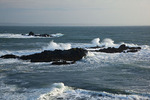 Maine, Quoddy Head State Park, waves breaking on offshore rocks