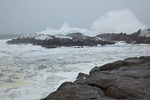 Maine, York Beach, Cape Neddick (Nubble Head), large waves breaking on rocky shore in record snow storm/blizzard of February 2013