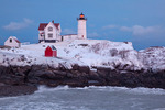 Maine, York Beach, Cape Neddick (Nubble Head) lighthouse with big waves in record snow storm/blizzard of February 2013