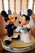 Mickey Mouse & Minnie Mouse Marry! Walt Disney created a magical world with his characters of fantasy.  The daily parade at Disney World, Orlando Florida is an exciting moment for kids and adults alike, as they encounter characters whom they've only imagined.  The realistic portrayal, music, costuming and performance by the actors/players enhances the crowds' enjoyment!