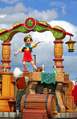 Pinocchio Dances for the Crowd! Walt Disney created a magical world with his characters of fantasy. The daily parade at Disney World, Orlando Florida is an exciting moment for kids and adults alike, as they encounter characters whom they've only imagined. The realistic portrayal, music, costuming and performance by the actors/players enhances the crowds' enjoyment!