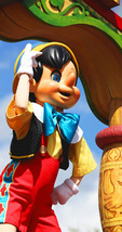 Pinocchio Dances! Walt Disney created a magical world with his characters of fantasy. The daily parade at Disney World, Orlando Florida is an exciting moment for kids and adults alike, as they encounter characters whom they've only imagined. The realistic portrayal, music, costuming and performance by the actors/players enhances the crowds' enjoyment!