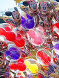 Mickey Mouse Balloons in Sunlight! Walt Disney created a magical world with his characters of fantasy. The daily parade at Disney World, Orlando Florida is an exciting moment for kids and adults alike, as they encounter characters whom they've only imagined. The realistic portrayal, music, costuming and performance by the actors/players enhances the crowds' enjoyment!   