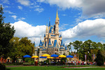 The Magic Kingdom Castle & Clouds!  Walt Disney created a magical world with his characters of fantasy. The daily parade at Disney World, Orlando Florida is an exciting moment for kids and adults alike, as they encounter characters whom they've only imagined. The realistic portrayal, music, costuming and performance by the actors/players enhances the crowds' enjoyment!   