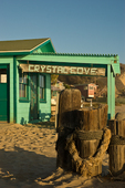 "The most distinct element of the 2,800-acre Crystal Cove State Park is its beach cottages, several of which have been restored.  This was the former store. Some are available for overnight stays, others are used for environmental education programs and administrative offices.  For decades the rustic cottages were casual summer and year-round homes, attracting families and artists.  The National Register of Historic Places term the cottages ""the last intact example of California beach vernacular architecture.""  Crystal Cove State Park is in Laguna Beach in Southern California."