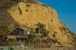 "The most distinct element of the 2,800-acre Crystal Cove State Park is its beach cottages, several of which have been restored.  Some are available for overnight stays, others are used for environmental education programs and administrative offices. This is Cottage 13, which appeared in the 1988 Bette Midler film ""Beaches.""  For decades the rustic cottages were casual summer and year-round homes, attracting families and artists.  The National Register of Historic Places term the cottages ""the last intact example of California beach vernacular architecture.""  Crystal Cove State Park is in Laguna Beach in Southern California."