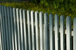 White fence at Colonial Williamsburg. Colonial Williamsburg's 301-acre Historic Area includes 88 original 18th-century structures, many of which are open to the public.  It is a town-size museum, exhibiting 18th-century Williamsburg as it was on the eve of the Revolution. At that time Williamsburg was the capital of the Colony of Virginia.  Exhibition sites, costumed historic interpreters and demonstrations of colonial crafts and trade bring the 1770s back to life.