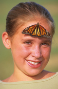 Monarch butterfly on 10 year old girl.