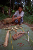 Pak Alec with tools and ingredients to make poison for hunting with bow and arrows.