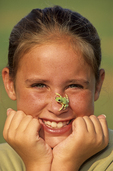 10 year old girl with tiger legged monkey tree frog