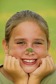 10 year old girl with green tree frog