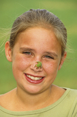 10 year old girl, Jessica Miles with green tree frog
