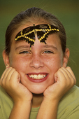Ten year old girl with a giant swallowtail butterfly