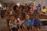 Mentawain children and Lisa Paciulli at Catholic Church during Sunday mass