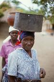 Zambian woman balancing pots on their heads