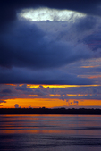 Sunset and rain clouds over Amazon River