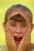 10 year old girl, Jessica Miles with monarch butterfly