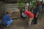 Birute Galdikas, PhD., Michelle, Pak Bohap and assistants from Orangutan Foundation International confiscating a juvenile Bornean Orangutan.