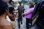 Birute Galdikas and PPA Official confiscating a Long-tailed macaque.
